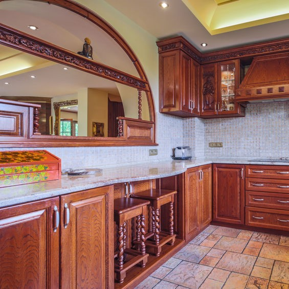 brown kitchen with marble counters