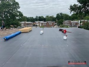 Black Membrane Roofing Being Installed