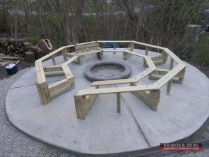 Concrete Firepit with Wooden Bench Being Constructed