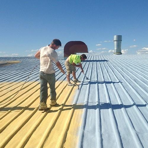 A Contractor Coats a Metal Roof.