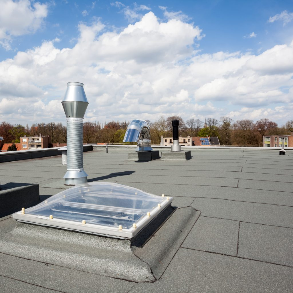 flat roof installed on roof with skylight