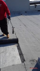 Modified Bitumen Roofing Being Installed