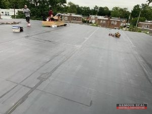 Roofers On a Black Membrane Roof