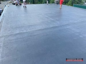 Roofers On EPDM Roof