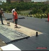 Roofers Repairing Roof