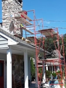 Stone Chimney Being Repaired